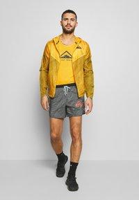 Nike Performance - RISE 365 TANK TRAIL - Camiseta de deporte - speed yellow/black - 1