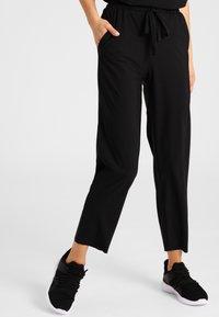 Daquïni - Trousers - black - 0