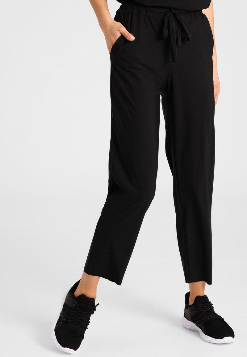 Daquïni - Trousers - black