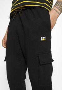 Caterpillar - Pantalones deportivos - black - 5