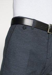 Tommy Hilfiger Tailored - FLEX SLIM FIT PANT - Kalhoty - black - 3
