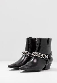 Calvin Klein - PALMMA - Cowboy/biker ankle boot - black - 4