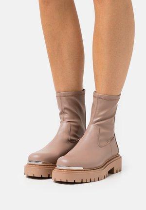 ALIMA - Platform ankle boots - bone