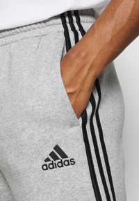 adidas Performance - CUT - Tracksuit bottoms - medium grey heather/black - 4