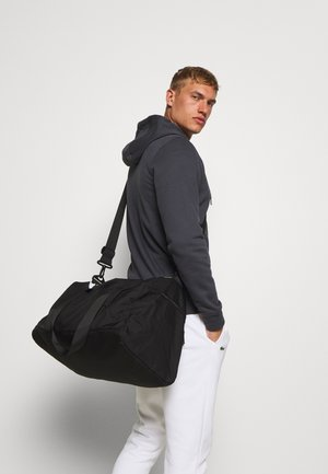 PETE SPORTSBAG - Sports bag - black