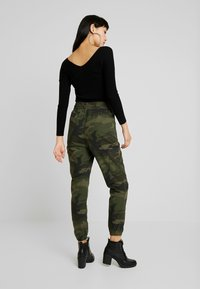 Hollister Co. - ULTRA HIGH RISE JOGGER - Trousers - olive - 3