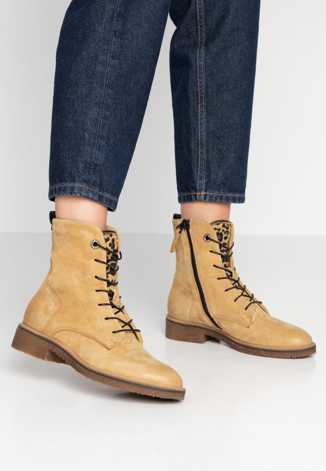 Lace-up ankle boots - bisanzio