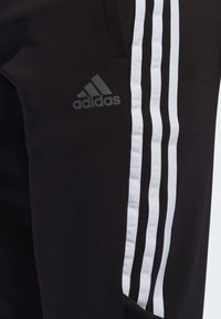 adidas Performance - RUN IT 3-STRIPES ASTRO JOGGERS - Pantalon de survêtement - black - 6