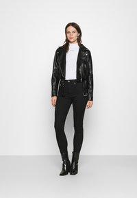 Calvin Klein Jeans - MICRO BRANDING STRETCH MOCK NECK - Print T-shirt - bright white - 1