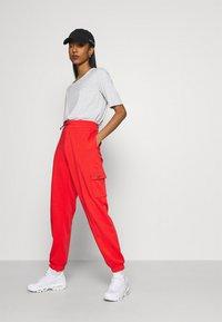 Nike Sportswear - PANT - Tracksuit bottoms - crimson/black - 3