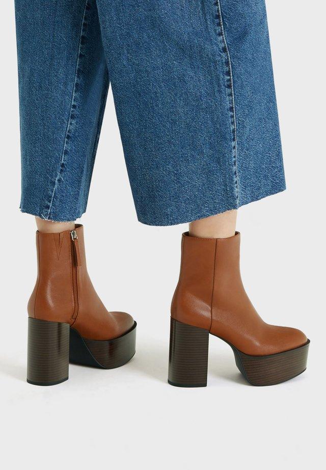 Boots à talons - ochre