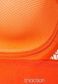 triaction by Triumph - HYBRID LITE - High support sports bra - orange - 6