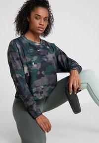 Nike Performance - REBEL ALL IN - Sweatshirt - dark green - 0