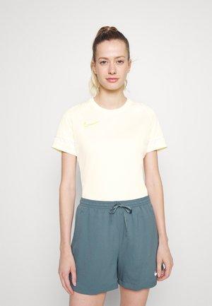 T-shirt med print - coconut milk/white/saturn gold