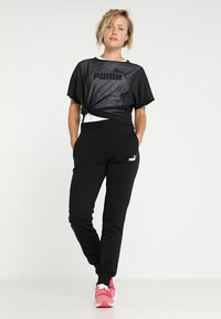 Puma - Pantalon de survêtement - cotton black - 1