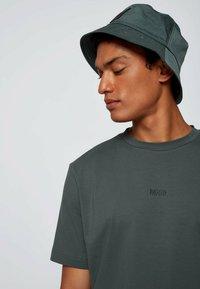 BOSS - TCHUP - Print T-shirt - dark green - 3