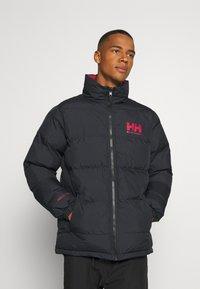Helly Hansen - REVERSIBLE PUFFER JACKET - Winter jacket - navy - 0