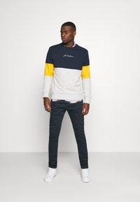 Diesel - D-LUSTER - Slim fit jeans - dark blue denim - 1