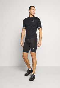 ODLO - SHORT ELEMENT - Leggings - black - 1