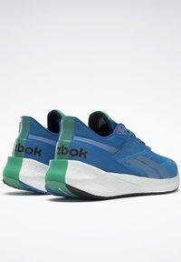 Reebok - FLOATRIDE ENERGY SYMMETROS SHOES - Stabilty running shoes - blue - 6