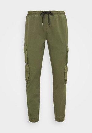 COMBAT - Cargo trousers - khaki