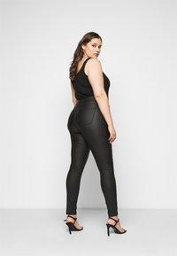 JUNAROSE - by VERO MODA - JRFOUR COATED PANTS - Jeans Skinny Fit - black - 2