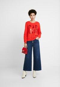 GAP - MONTANA - Flared jeans - dark indigo - 1