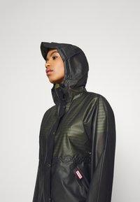 Hunter ORIGINAL - WOMENS ORIGINAL SMOCK - Waterproof jacket - dark olive - 4