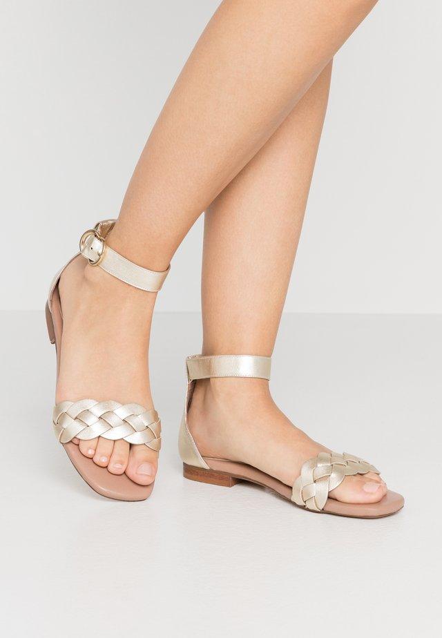 Sandals - metal platino