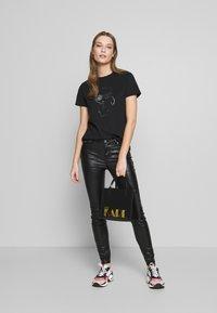 KARL LAGERFELD - COATED - Jeans Skinny Fit - black - 1