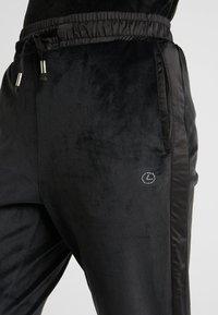 Luhta - ENANNIEMI - Spodnie treningowe - black - 5