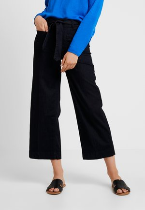 CULOTTE - Flared Jeans - clean rinsed blue denim