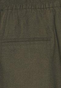 ONLY - ONLKELDA EMERY PULL UP PANTS - Pantalones deportivos - grape leaf - 5