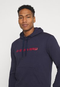 G-Star - GRAPHIC CORE HDD SW L\S - Hoodie - sartho blue - 3