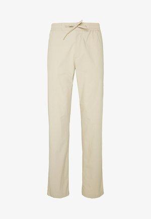 TRISTAN - Trousers - oat