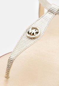 MICHAEL Michael Kors - MALLORY THONG - T-bar sandals - pale gold - 6