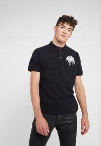 Just Cavalli - Polo shirt - black - 0