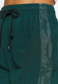 Reebok - PANT - Tracksuit bottoms - dark green - 5