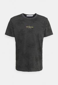 Calvin Klein Jeans - PALM GRAPHIC TEE UNISEX - T-shirt con stampa - black - 0