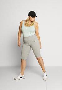 Nike Sportswear - W NSW ESSNTL - Leotard - pistachio frost/white - 1