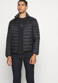 Calvin Klein - SMALL TONE LOGO - T-shirt med print - black - 4