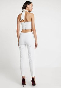 Club L London - GIRL BOSS TROUSERS - Leggings - white - 2