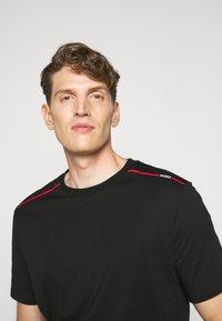 HUGO - DYRTID - T-shirts print - black - 3