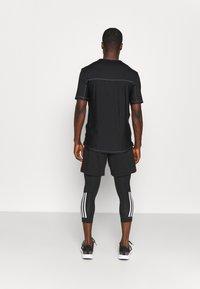 adidas Performance - 3 STRIPES PRIMEGREEN TECHFIT COMPRESSION CAPRI 3/4 LEGGINGS - Tights - black - 4