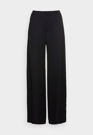 SLOW TROUSERS - Trousers - black fluid