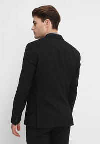 Calvin Klein Tailored - WOOL NATURAL STRETCH FITTED SUIT - Suit - perfect black - 3