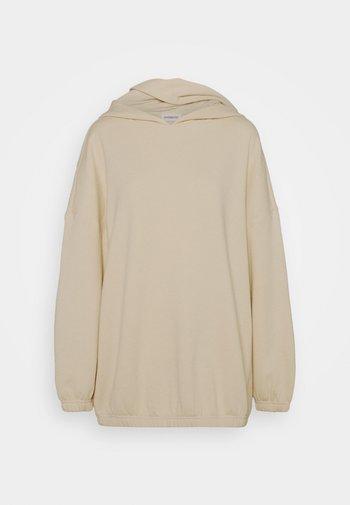 Long oversize hoodie with elastic hem