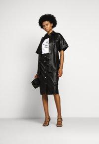 KARL LAGERFELD - CARGO - Button-down blouse - black - 1
