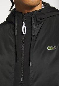Lacoste Sport - PREMIUMI JACKET - Winter jacket - black - 6