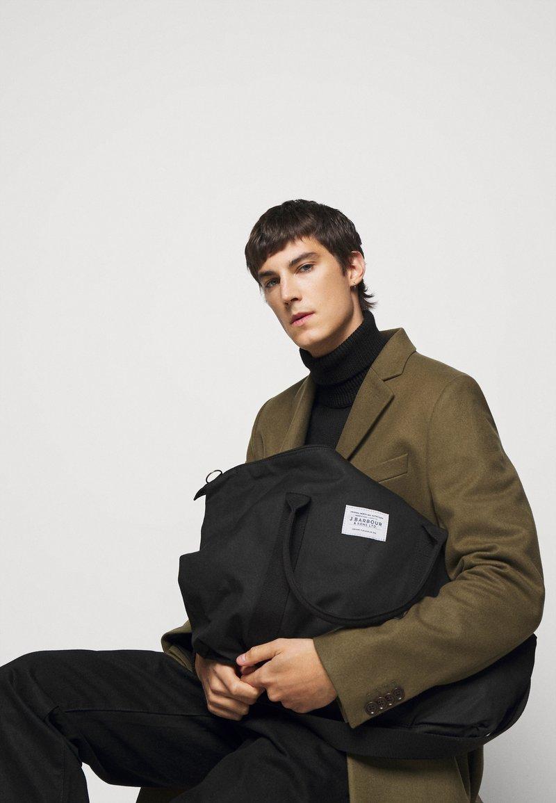Barbour - EADAN HOLDALL UNISEX - Weekend bag - black